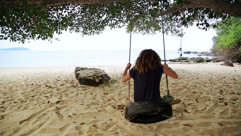tourist girl enjoying at swing at beach, sihanoukv Footage