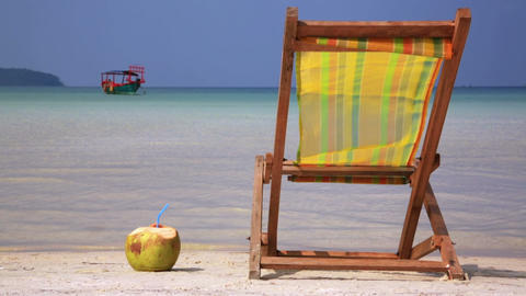 Sunbed and Coconut ready for holiday Stock Video Footage