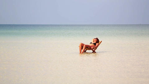 attractive woman sunbathing in gorgeous crystal wa Stock Video Footage
