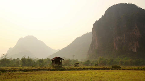 Backpacker heaven, Vang Vieng with limestone mount Stock Video Footage