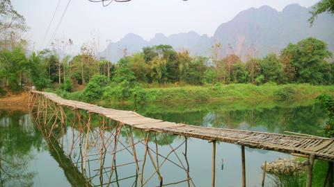 Majestic empty bamboo bridge, limestone mountains, Stock Video Footage