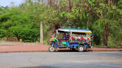 Single tuk tuk on road, Luang Prabang, Laos Footage