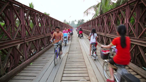 LUANG PRABANG, LAOS - APRIL 2014: motorbikes cross Stock Video Footage