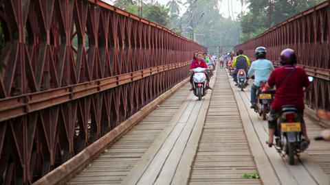 LUANG PRABANG, LAOS - APRIL 2014: motorbikes cross Stock Video Footage