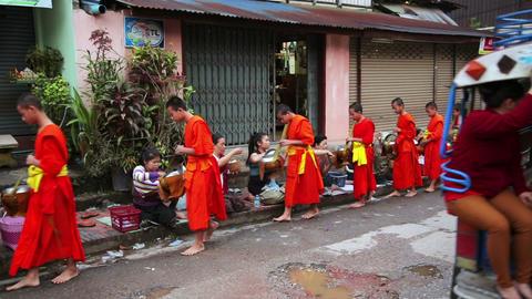 LUANG PRABANG, LAOS - APRIL 2014: people give rice Stock Video Footage