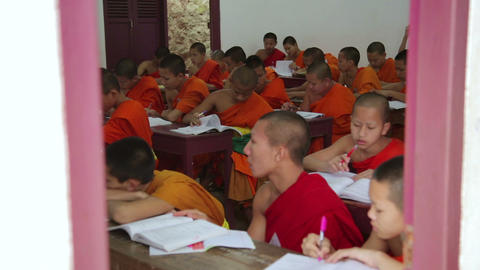 LUANG PRABANG, LAOS - APRIL 2014: buddhist monk sc Footage