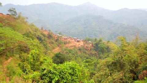 Zoom - Akha tribe village on mountain, Pongsali, L Stock Video Footage