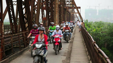 HANOI, VIETNAM - MAY 2014: motorbikes passing iron Stock Video Footage