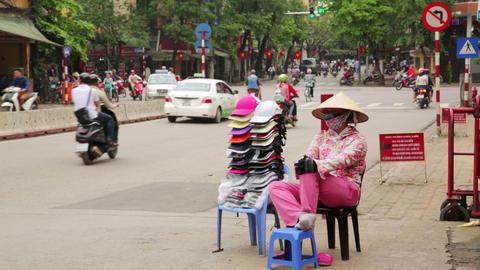 HANOI, VIETNAM - MAY 2014: street seller woman Footage