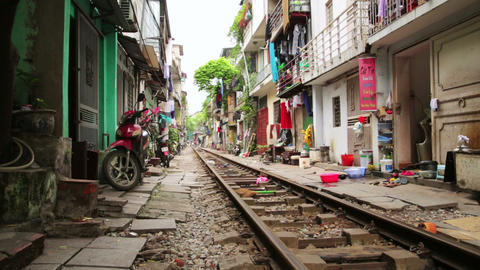 HANOI, VIETNAM - MAY 2014: train passing through s Stock Video Footage