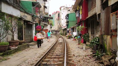 HANOI, VIETNAM - MAY 2014: train passing through s Footage