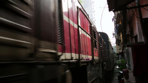 HANOI, VIETNAM - MAY 2014: train passing through s Footage