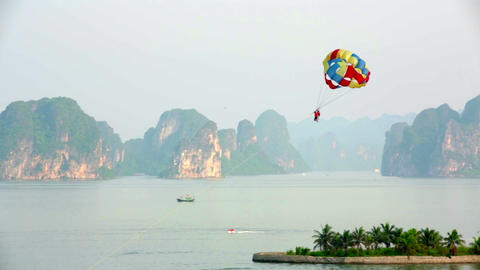 parasailing over limestone mountain islands, Halon Stock Video Footage