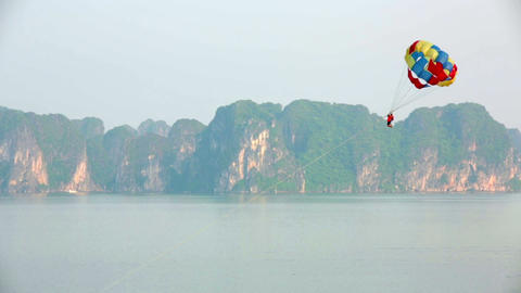 parasailing over limestone mountain islands, Halon Footage