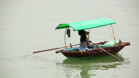 vietnamese woman with traditional dress paddling b Footage