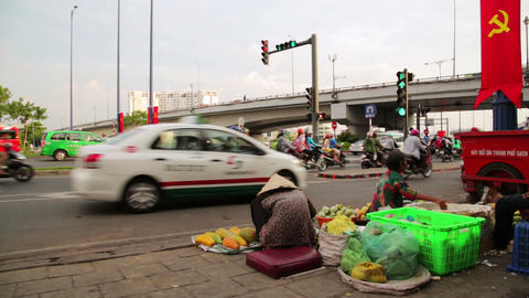 SAIGON, VIETNAM - MAY 2014: Vendor selling fruits, Stock Video Footage