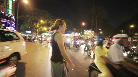 SAIGON, VIETNAM - MAY 2014: woman crossing street Stock Video Footage