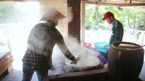 MEKONG DELTA, VIETNAM - MAY 2014: noodle makers Footage