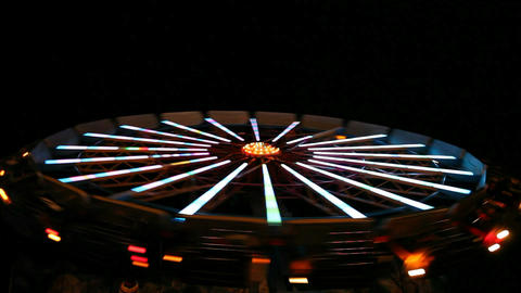 Spinning wheel in amusement park Stock Video Footage