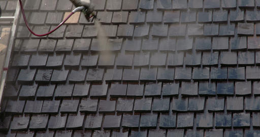 Cleaning of the newly installed wooden shingles FS Stock Video Footage