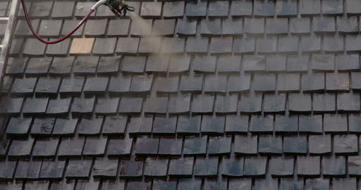 Cleaning of the newly installed wooden shingles FS Footage