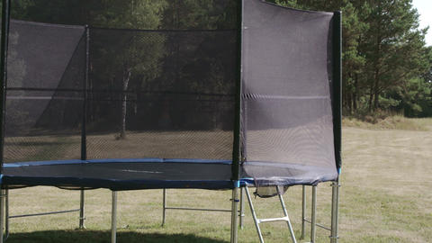 A Small Size Trampoline On The Backyard Of The Hou stock footage