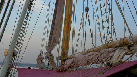 Ropes and rolled big clothes on the sail mast of t Footage