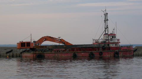 An old excavator on dock on the sea of Estonia GH4 Footage