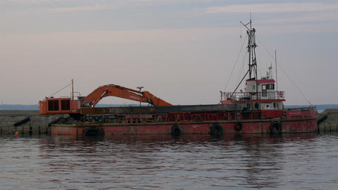 An old excavator on dock on the sea of Estonia GH4 Stock Video Footage