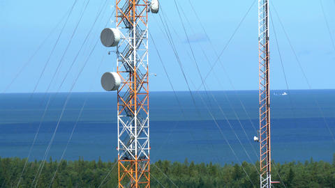 Two Tall Telecommunication Towers In The Middle Of stock footage