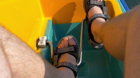 A mans feet paddling the water bicyle GH4 4K UHD Stock Video Footage