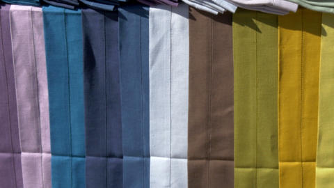 Lots Of Colorful Cloth On Display Hanging On The T stock footage