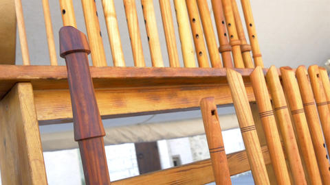 Lots Of Wooden Flutes On Display On The Rack GH4 4 stock footage