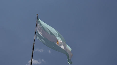 002 Argentina flag on blue sky Stock Video Footage
