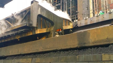 industrial kooks train out of oven Stock Video Footage