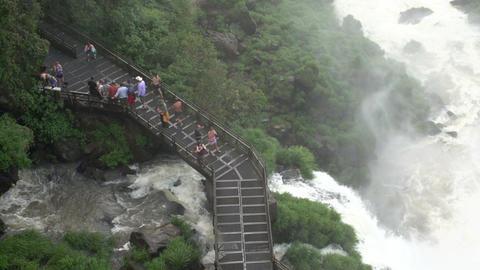054 Iguazu waterfalls , Argentina , people on brid Stock Video Footage