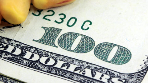 US Currency One Hundred Dollar Bill with Yellow Co Stock Video Footage