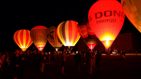 Beautiful Hot Air Baloons Glowing In The Night stock footage