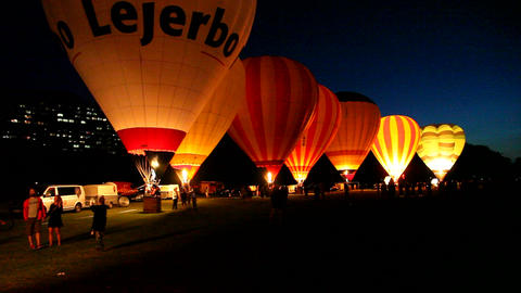 Hot Air Balloons Making A Night Glow stock footage