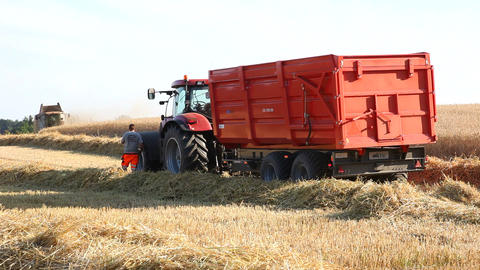 Tractor On A Field With Harvested Wheat stock footage