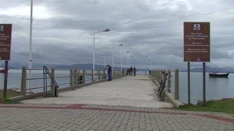 022 Florianopolis , fisherman throw his net in sea Footage