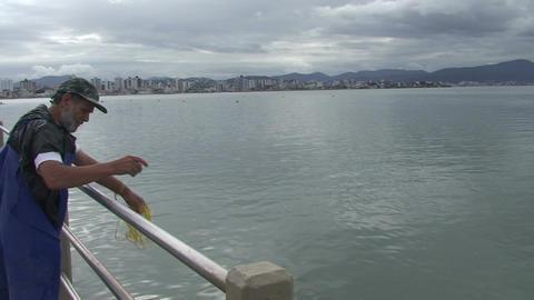 026 Florianopolis , fisherman throw his net in sea Footage