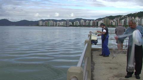 028 Florianopolis , fisherman throw his net in sea Footage