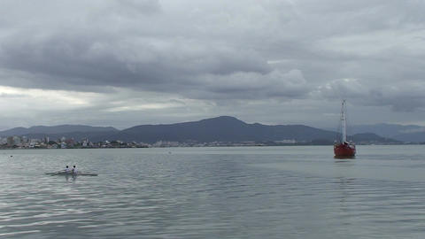 035 Florianopolis , red boat in sea , kano passing Footage