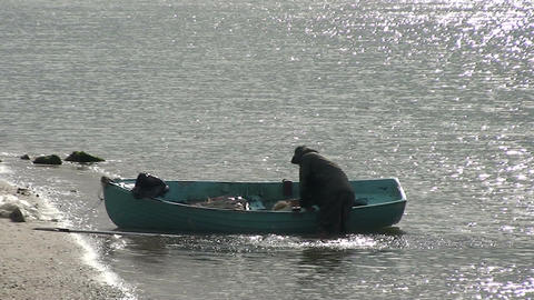 042 Florianopolis , fisherman troughs water out th Stock Video Footage