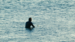 Surfer Waiting for the Next Wave Stock Video Footage