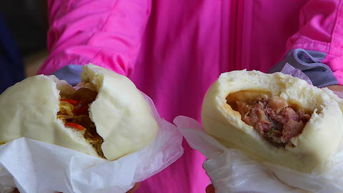 up-close macro inside two steamed buns (baozi) Footage