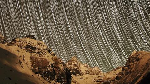 Time lapse of stars behind mountains Kyajo, Pharil Footage