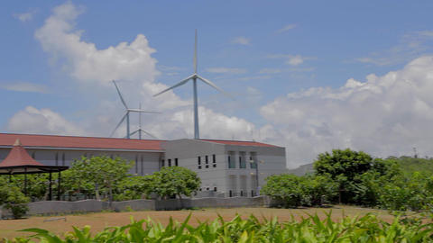 pan - wind turbine at kenting Houbihu bay Stock Video Footage