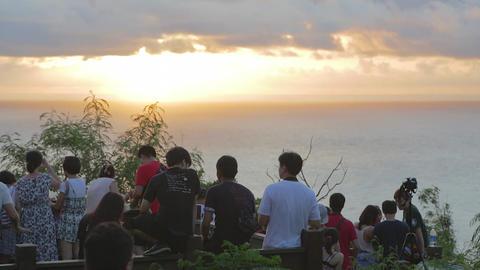 close up - people enjoying sunset at guanshan 2 Stock Video Footage